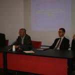 Il dott.P.O.Carli introduce l'intervento del dott.R.Mele (a sinistra)